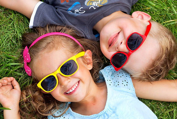 Kids with Glasses Smiling - Pediatric Dentist & Orthodontist in Dallas, TX